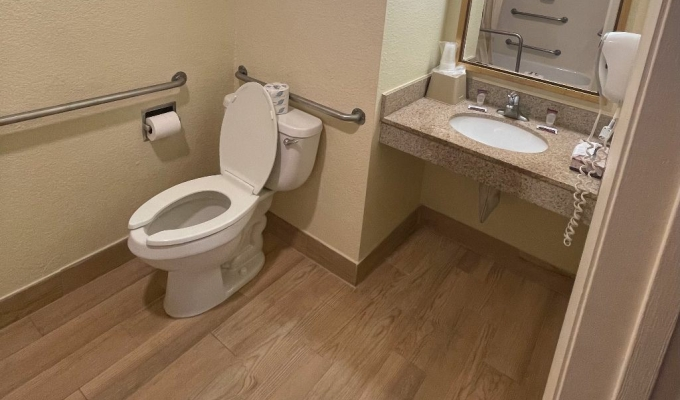Accessible room raised toilet
